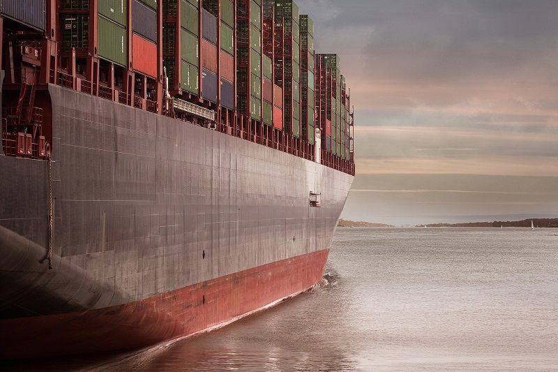 Ship loaded with shipping containers | process for moving overseas | AW Transportation