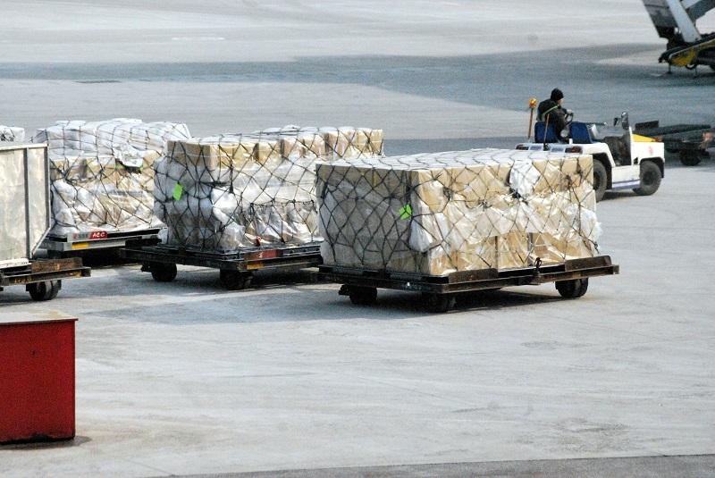 Air Cargo on Tarmac | International Sea and Air Shipping | AW Transportation